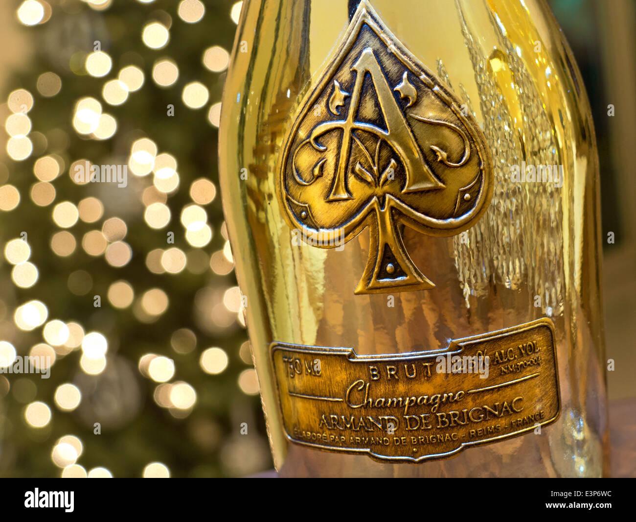 Distinctive metallic gold bottle of Armand de Brignac ' Ace of Spades'' fine luxury champagne with sparkling - Stock Image