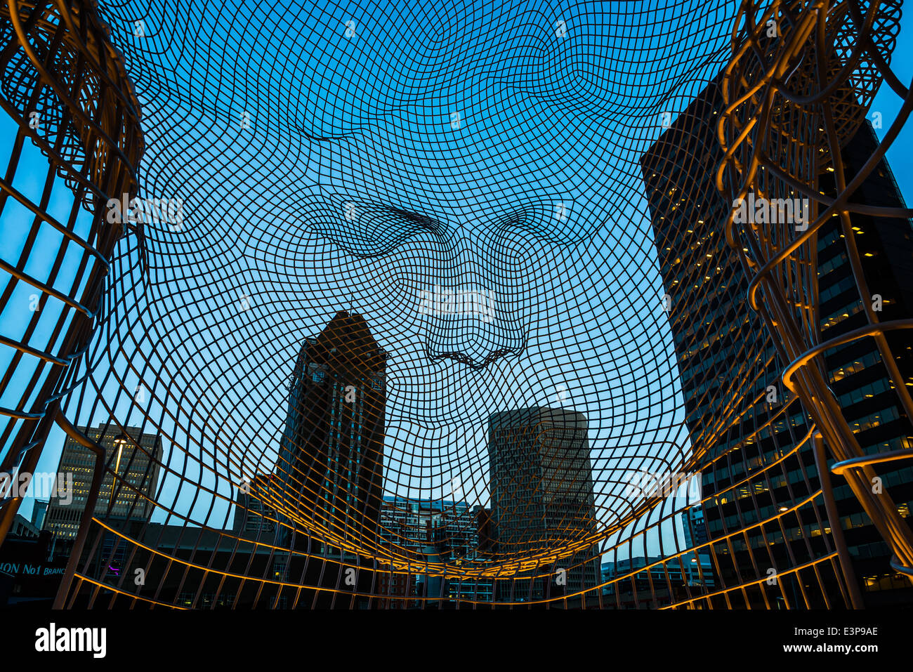 Evening view from inside the sculpture titled 'Wonderland' by Jaume Plensa. The Bow Tower, Calgary, Alberta, - Stock Image