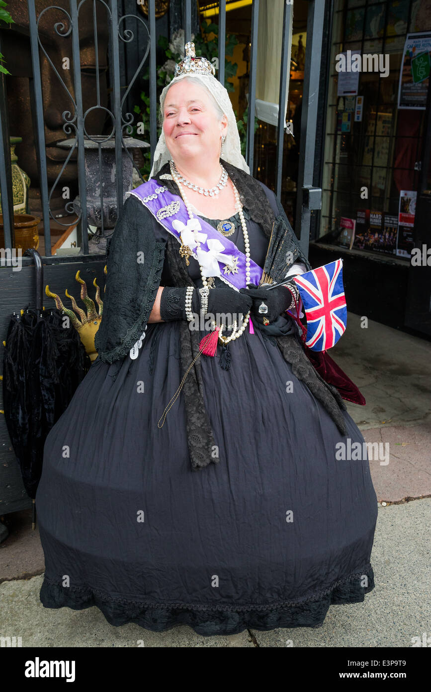 Woman dressed as Queen Victoria. - Stock Image