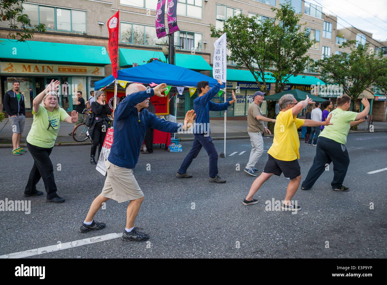 Adults demonstrating Tai Chi, Car Free Day, Main Street, Vancouver, British Columbia, Canada - Stock Image