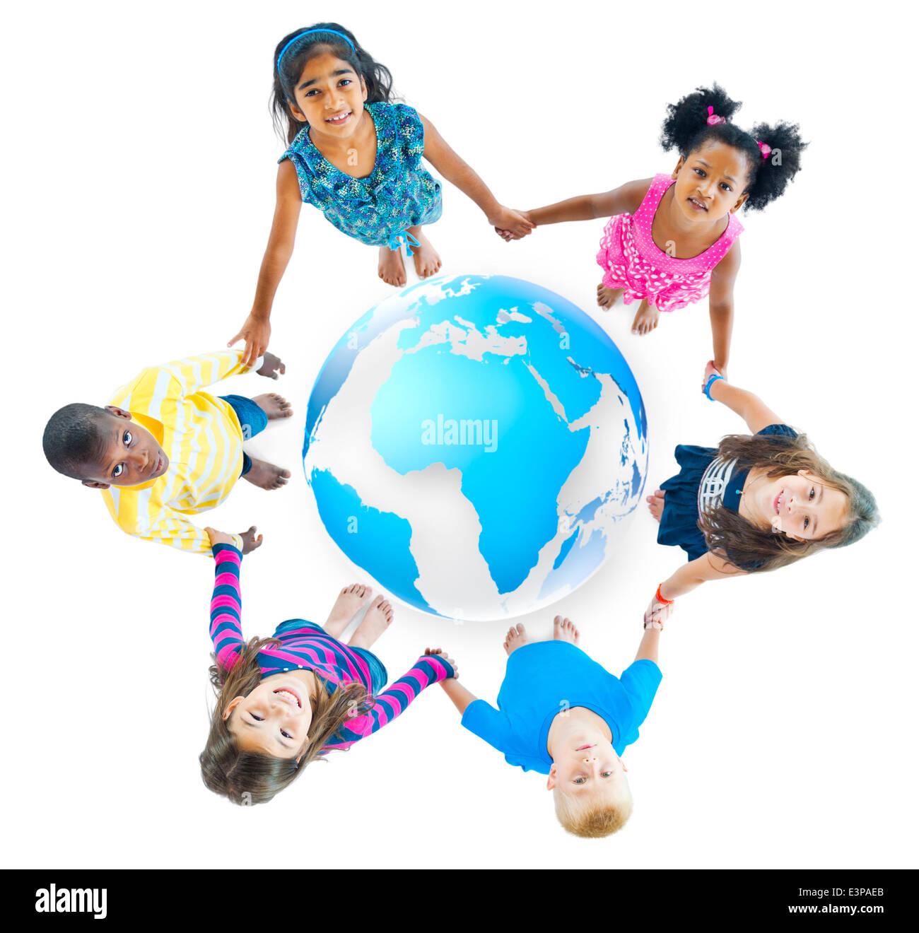 Multiethnic Children Holding Hands Around Globe - Stock Image