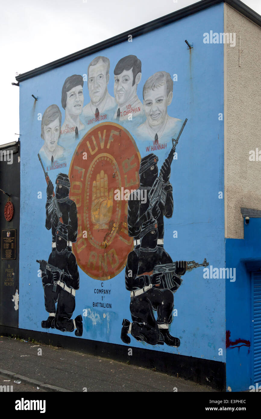 An Ulster Volunteer Force Mural in the Loyalist area of West Belfast showing the UVF, with hooded paramilitaries Stock Photo