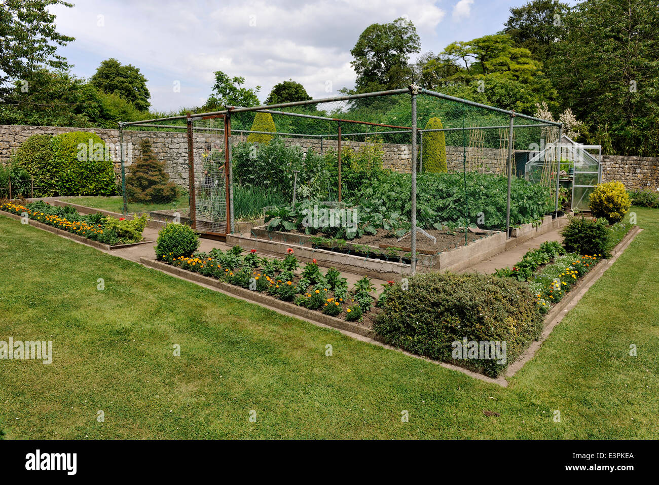 Fenced Off Vegetable Plot, in a garden in Great Elm, near Mells, Somerset. - Stock Image