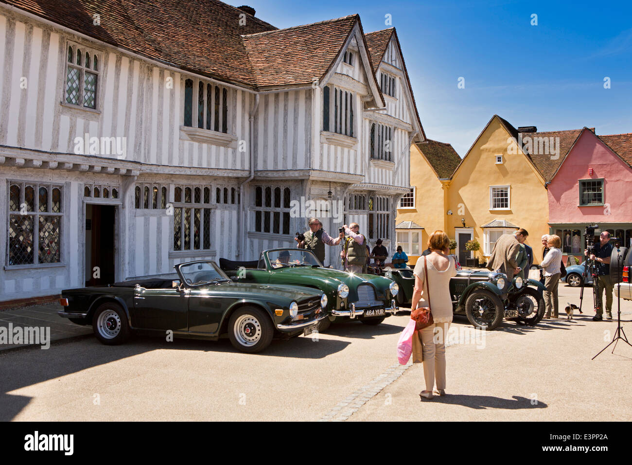 UK England, Suffolk, Lavenham, Market Square, classic car photoshoot outside Guildhall - Stock Image