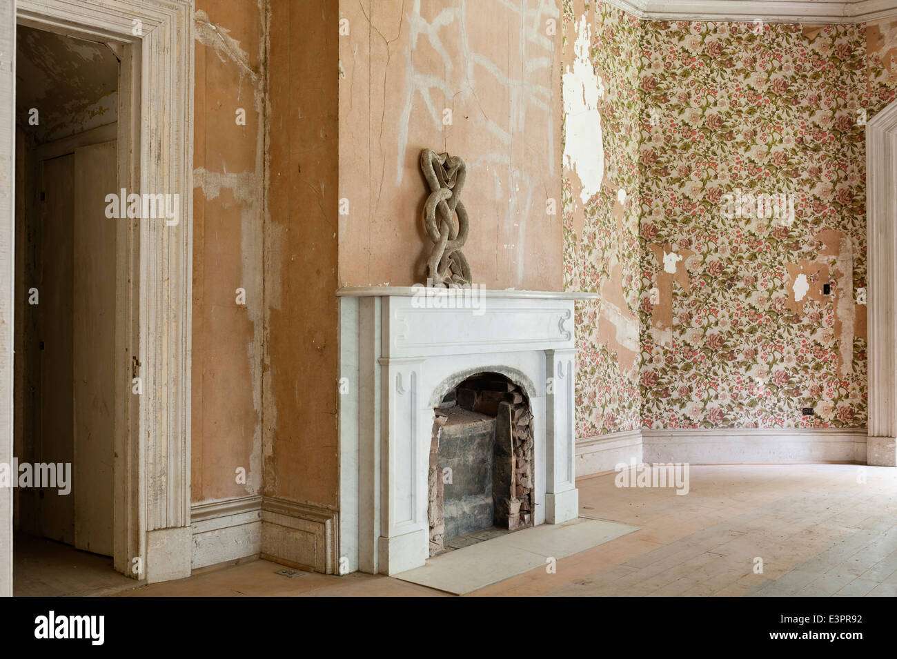 Old Bricked Up Fireplace In Empty Room With Peeling