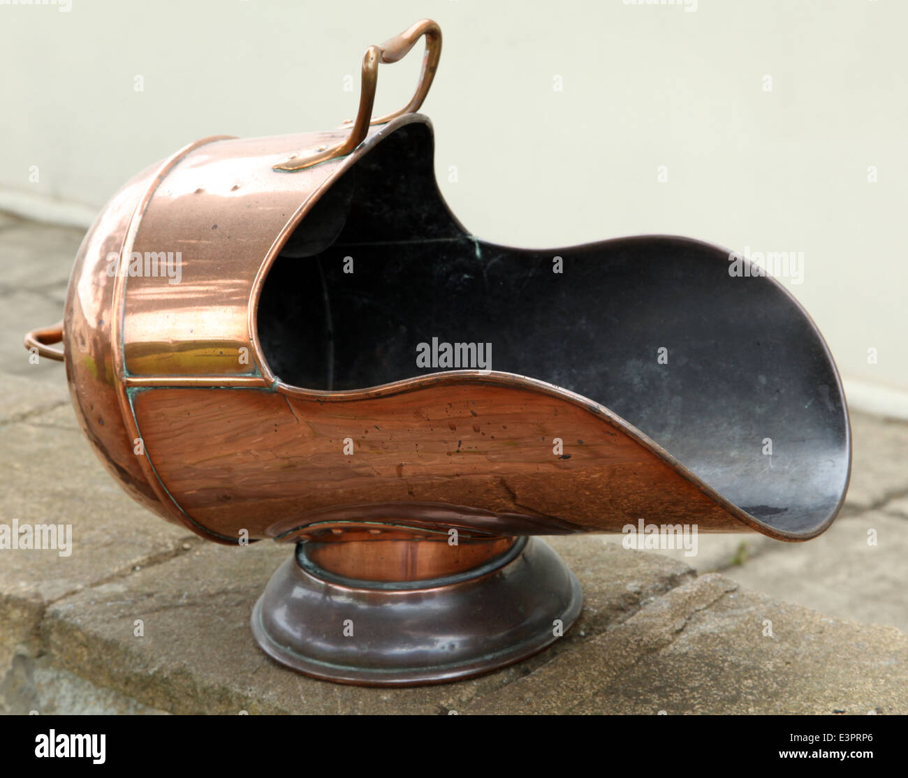 an antique brass coal scuttle - Stock Image