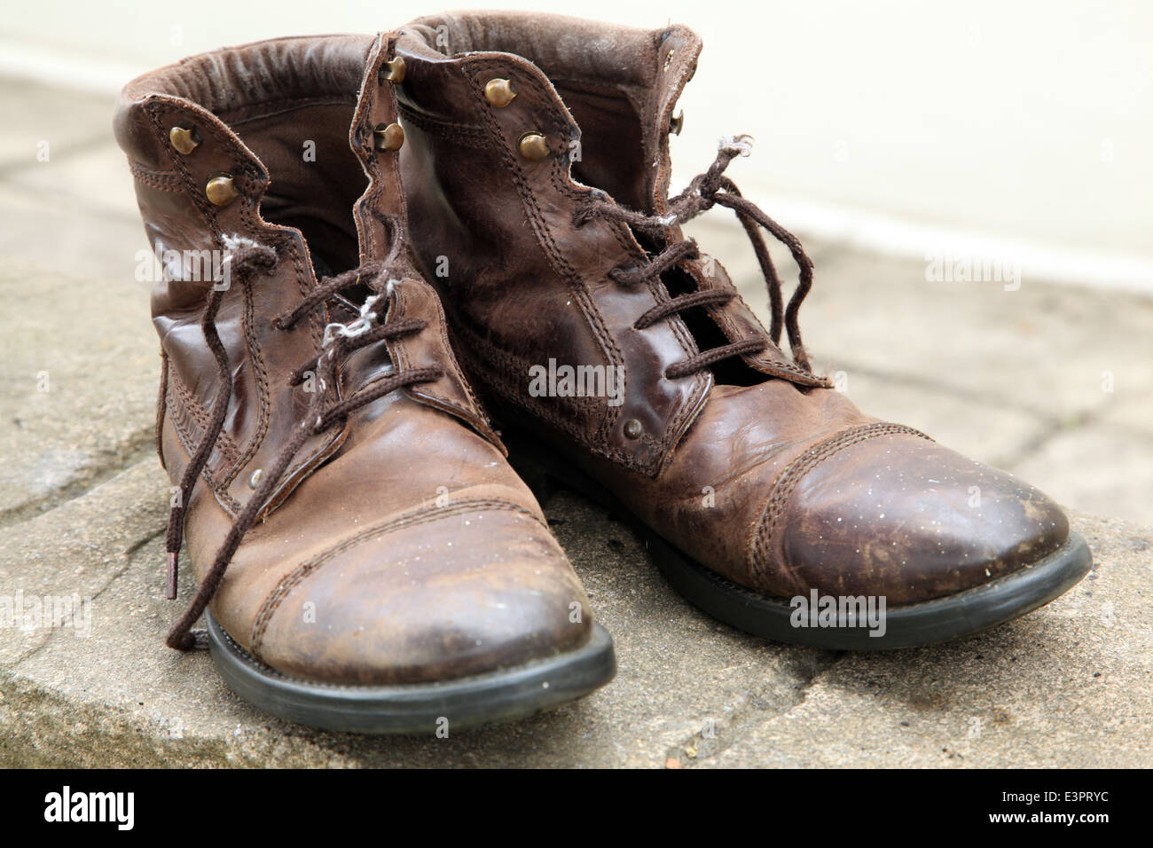 122e942c6836 an old pair of brown leather boots with tatty laces Stock Photo ...