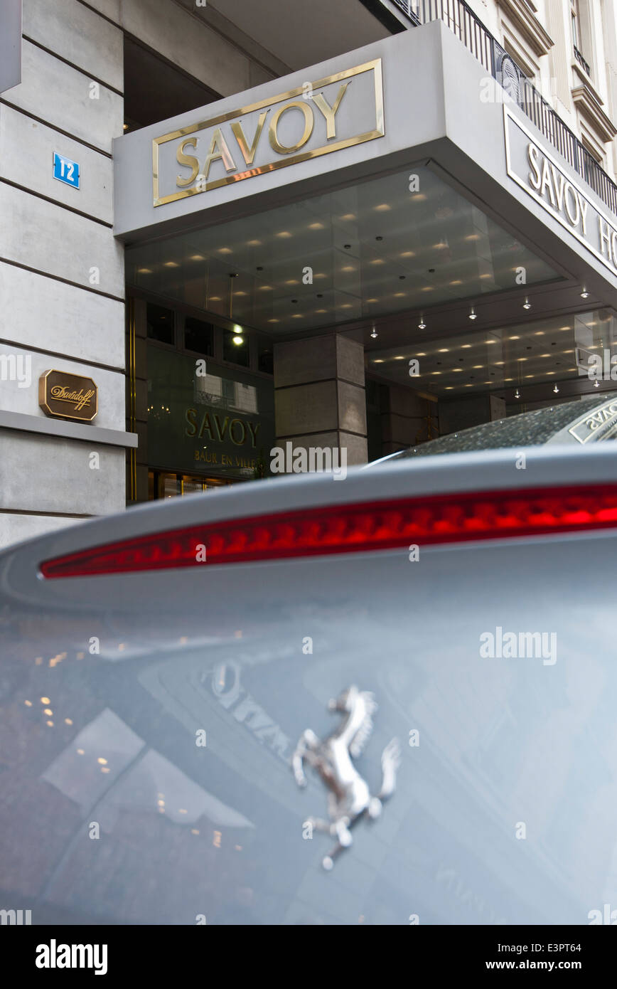 A Ferrari parked outside the Savoy luxury Hotel on Zurich's Bahnhofstrasse. - Stock Image