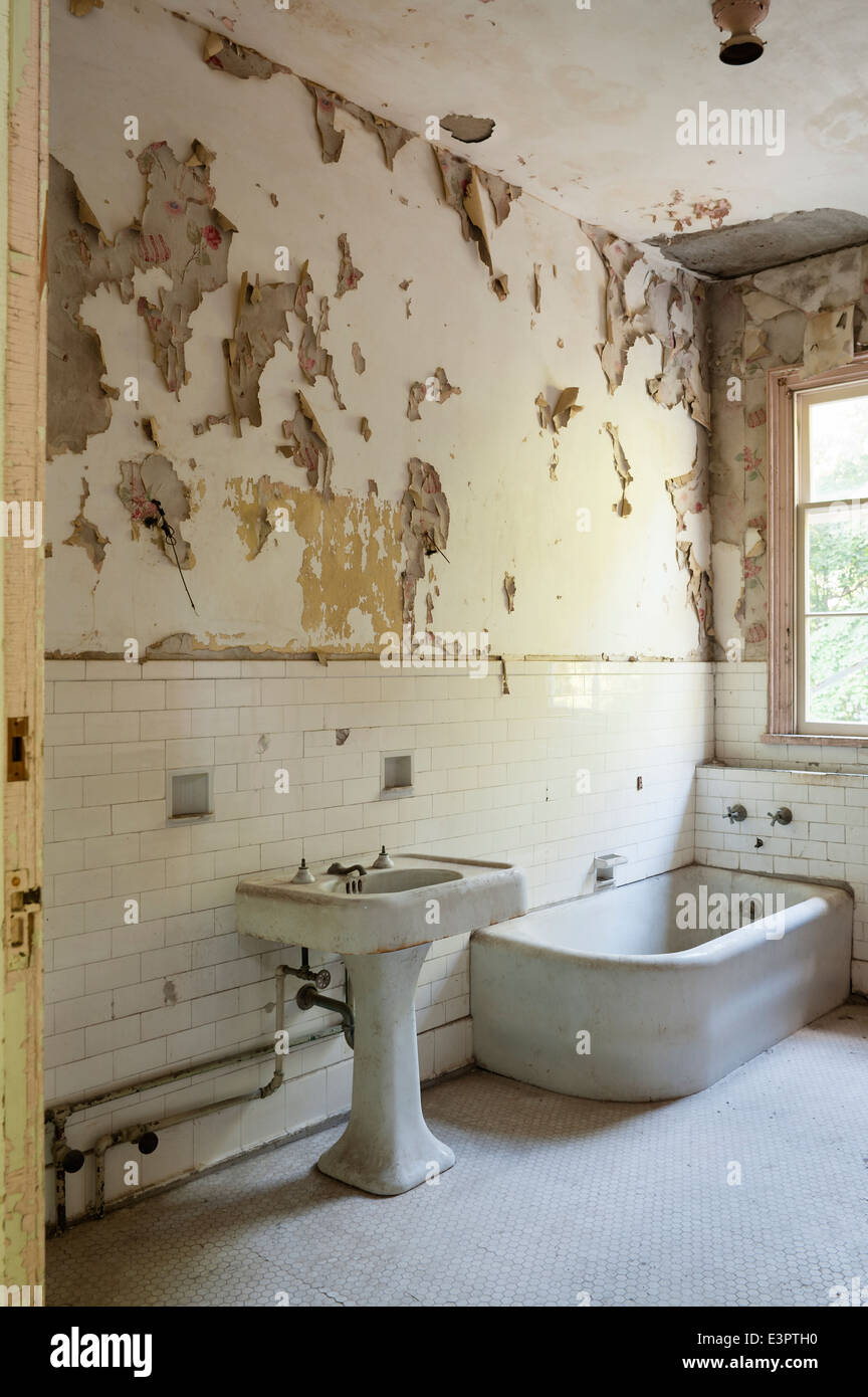 Old Bathroom With Torn Peeling Wallpaper White Wall Tiling
