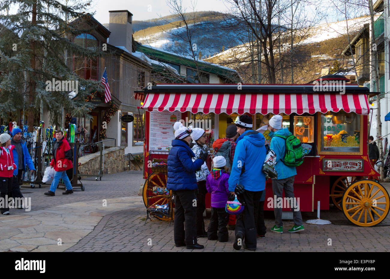 Tourists buying snacks and popcorn in winter at Vail Colorado - Stock Image