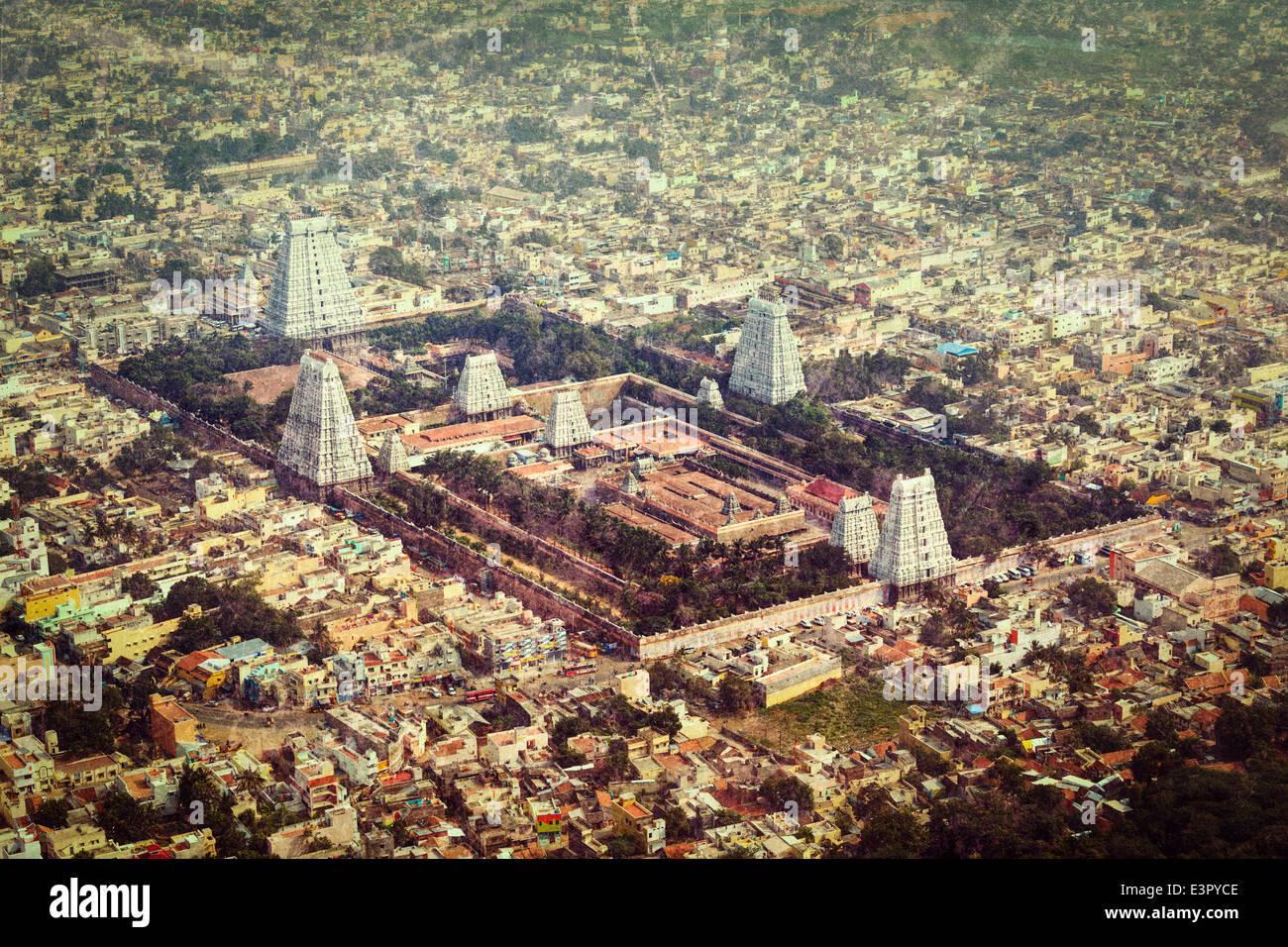 Vintage retro hipster style travel image Arulmigu Arunachaleswarar Hindu Temple and indian city Tiruvannamalai, - Stock Image