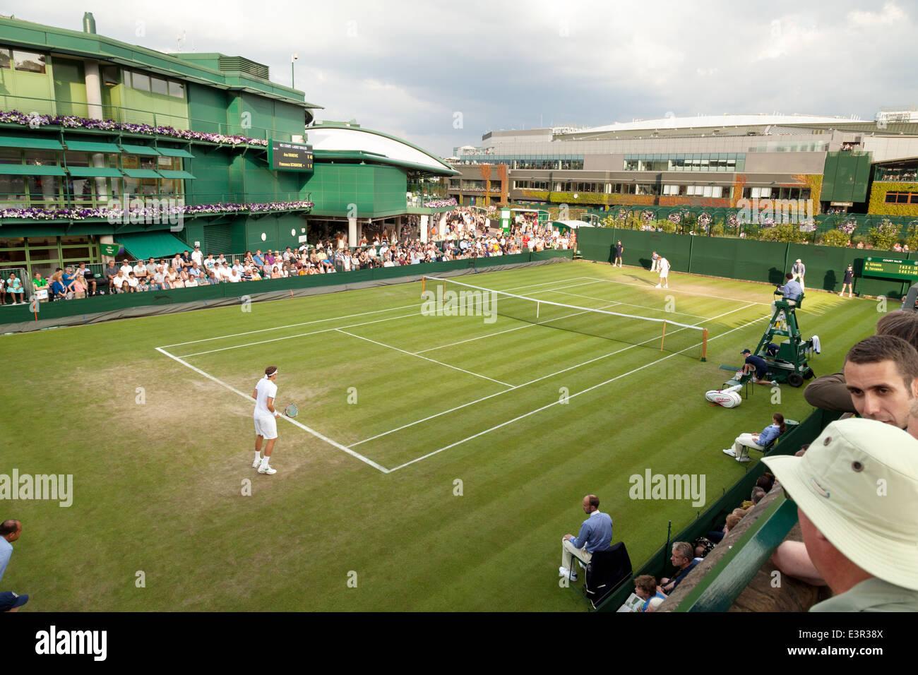 Tennis match on an outside court, the Wimbledon All England Lawn Tennis Club Championships, Wimbledon London UK - Stock Image