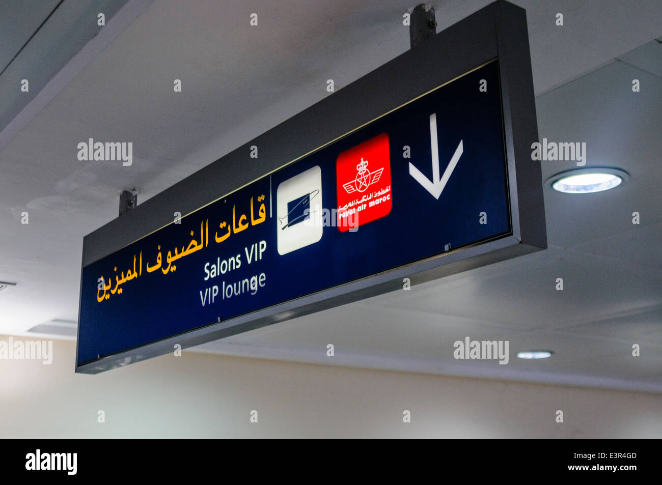 Sign to the airport lounges in Arabic, French and English at Marakech International Airport, Morocco - Stock Image