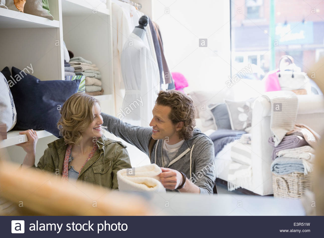 Couple looking at towels in shop - Stock Image