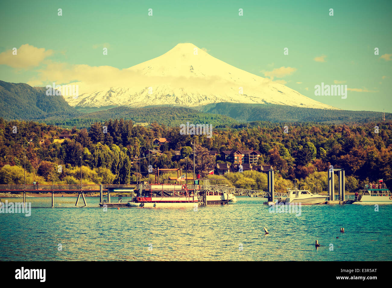 Snow covered Volcano Villarica, Chile, vintage retro style. - Stock Image