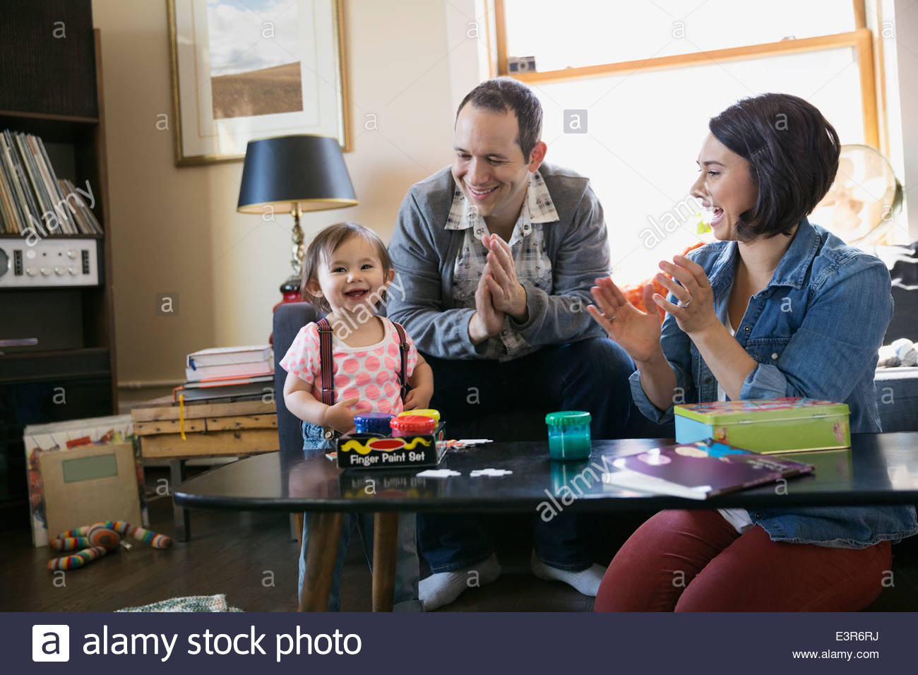 Young family playing in living room Stock Photo