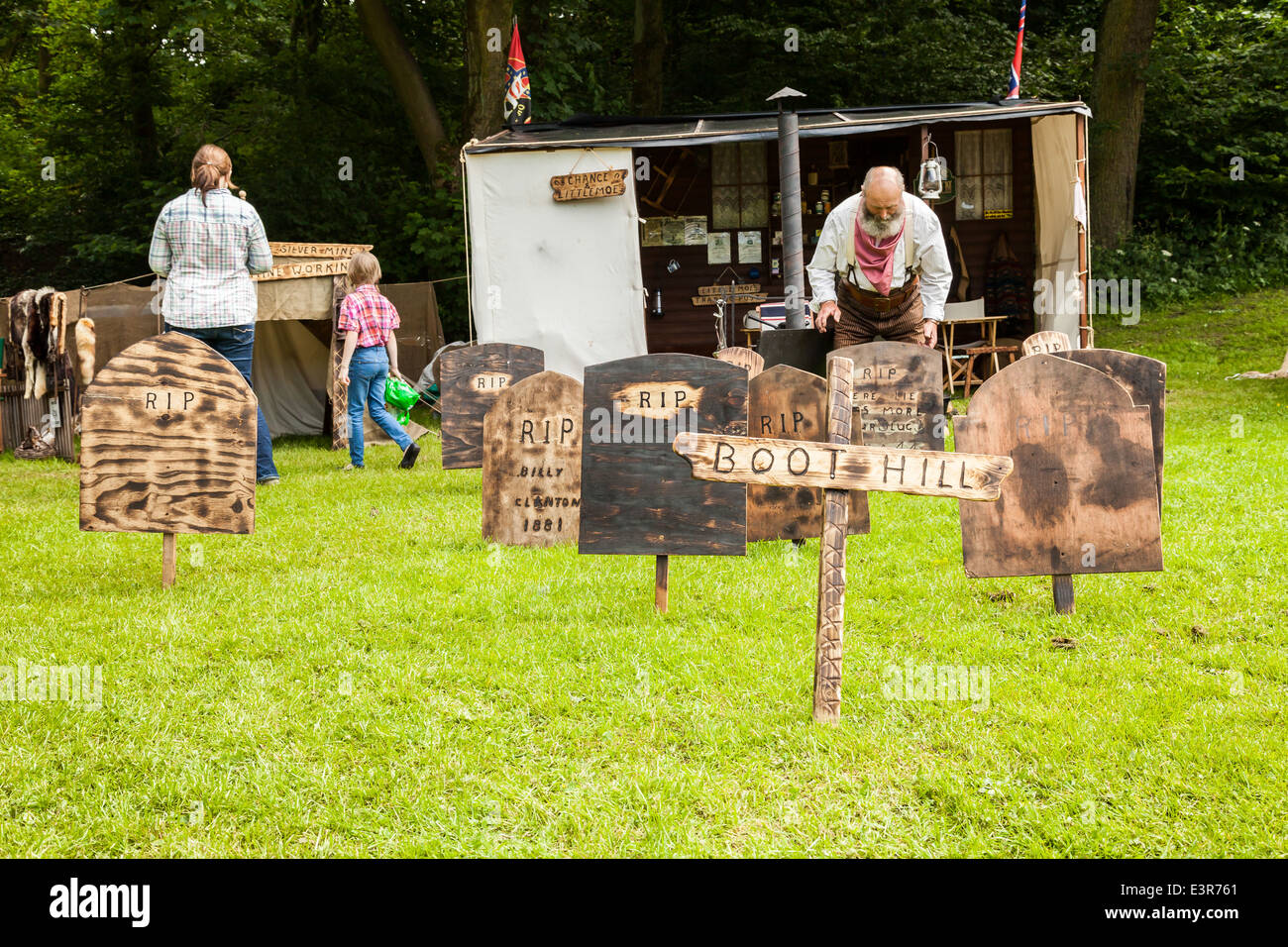 Leek, Staffordshire, England. 22nd June 2014, A Western Weekend. Man tidying up the wooden tombstone props on boot - Stock Image