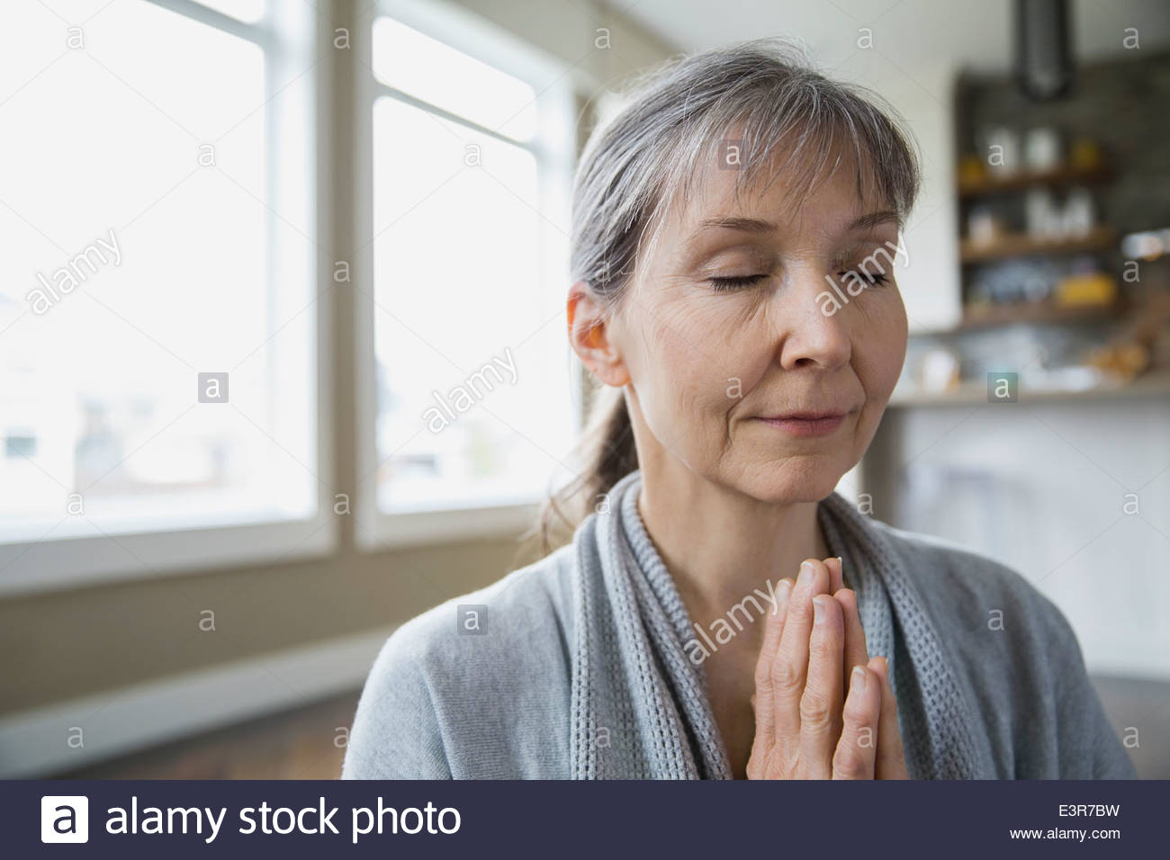 Close up of woman meditating - Stock Image