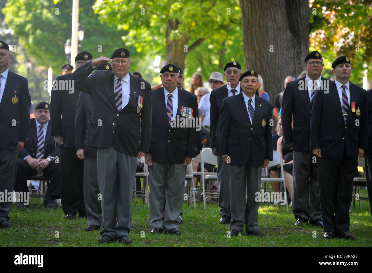 Politicians, members of  the public, veterans and serving military personnel attend a ceremony on the 70th anniversary - Stock Image