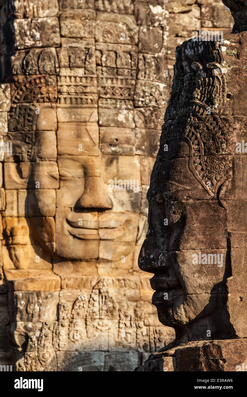 Ancient stone faces of Bayon temple, Angkor, Cambodia - Stock Image