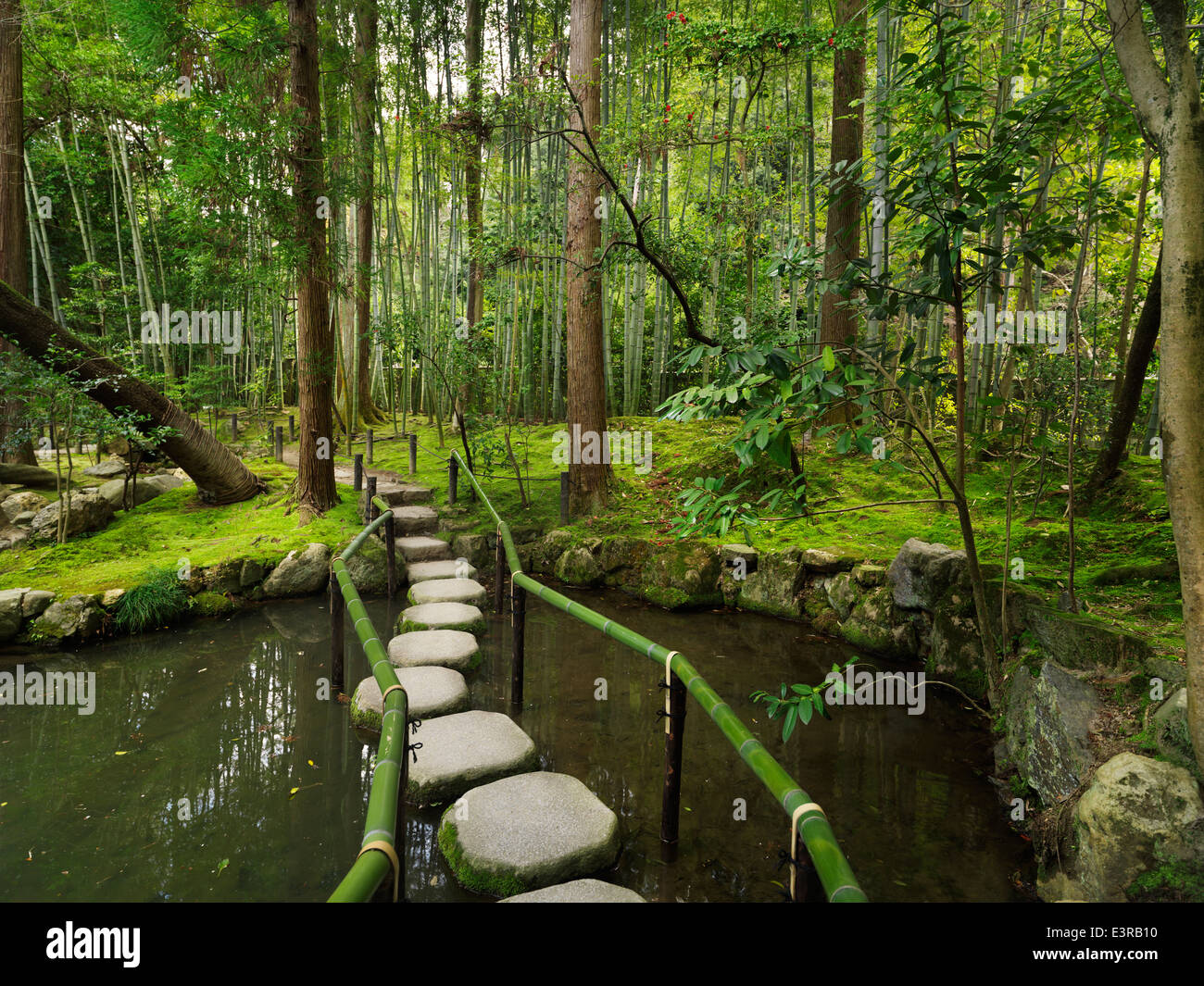Japanese Zen garden with stepping stones over a pond. Kyoto, Japan. - Stock Image