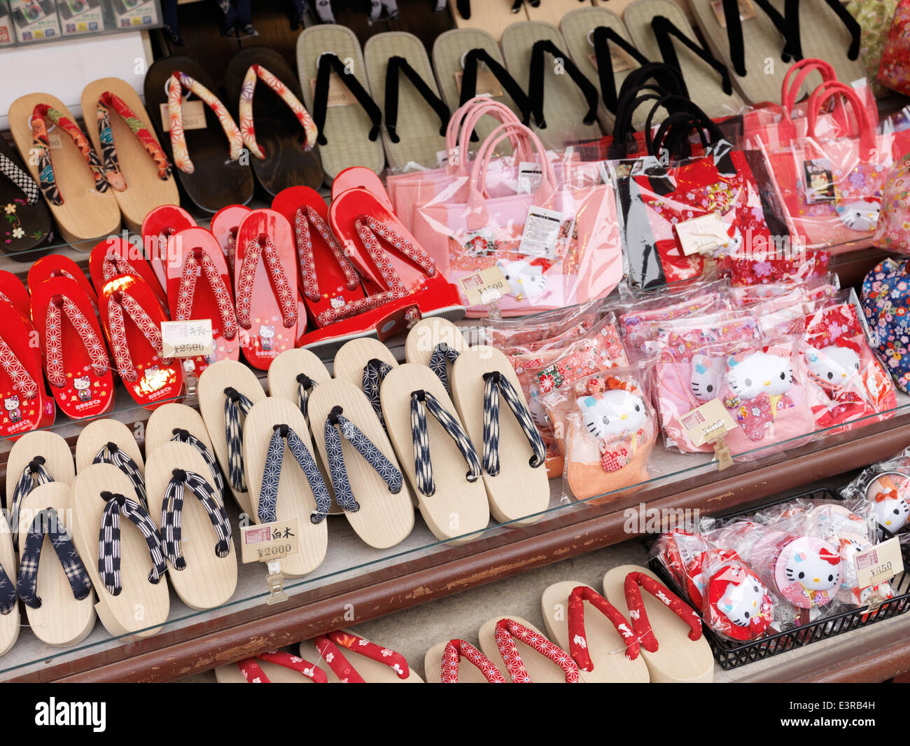 Japanese zori sandals and Hello kitty bags on display in a souvenir store. Kyoto, Japan. - Stock Image