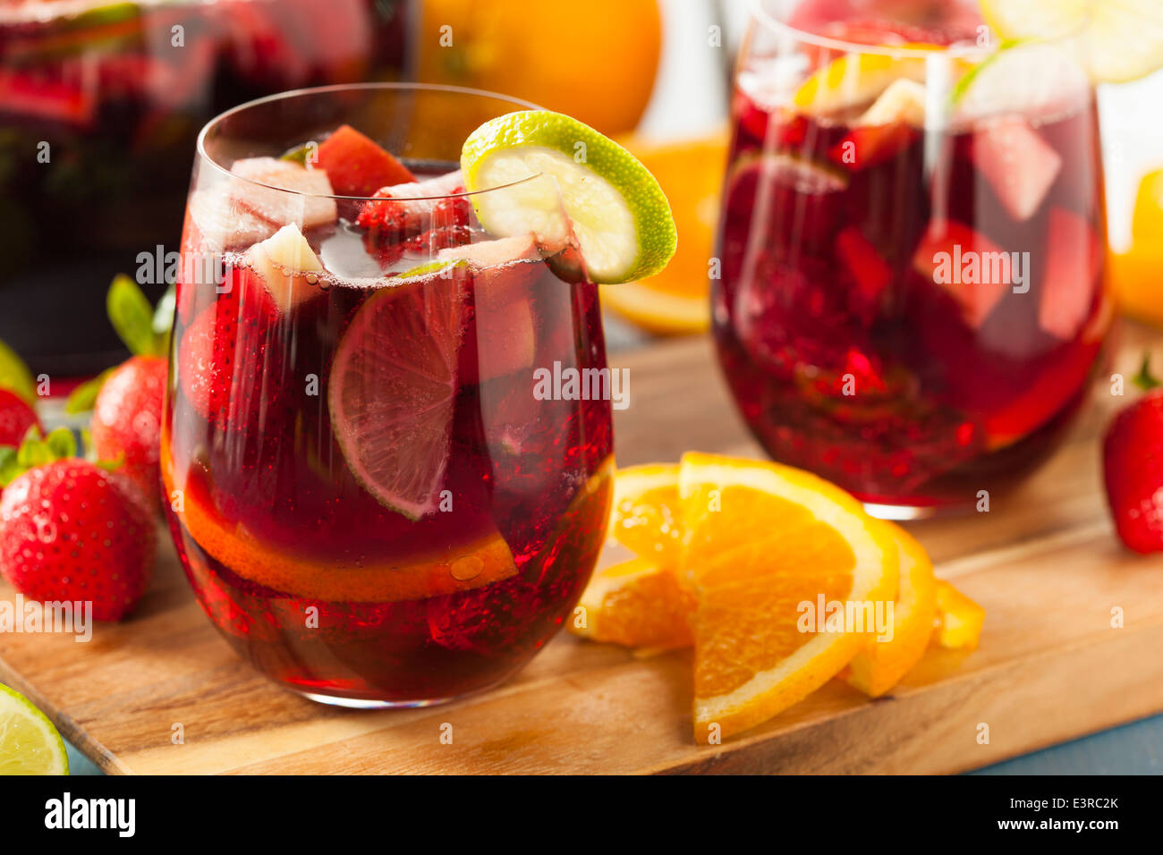 Homemade Delicious Red Sangria with Limes Oranges and Apples - Stock Image