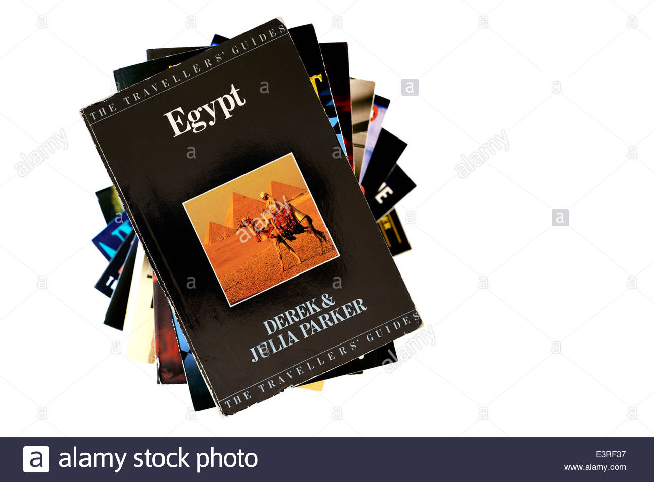 Old travel guide to Egypt, book title, stacked used books, England - Stock Image