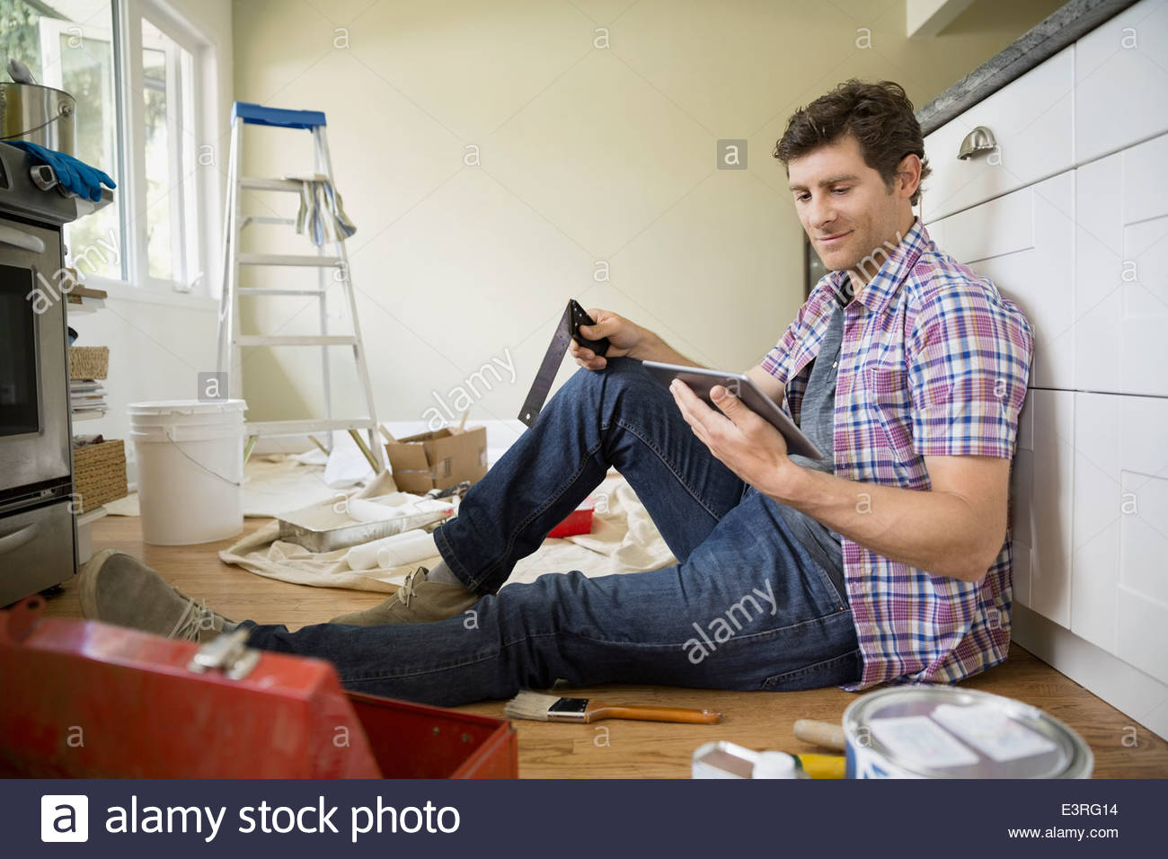 Man with digital tablet starting painting project - Stock Image