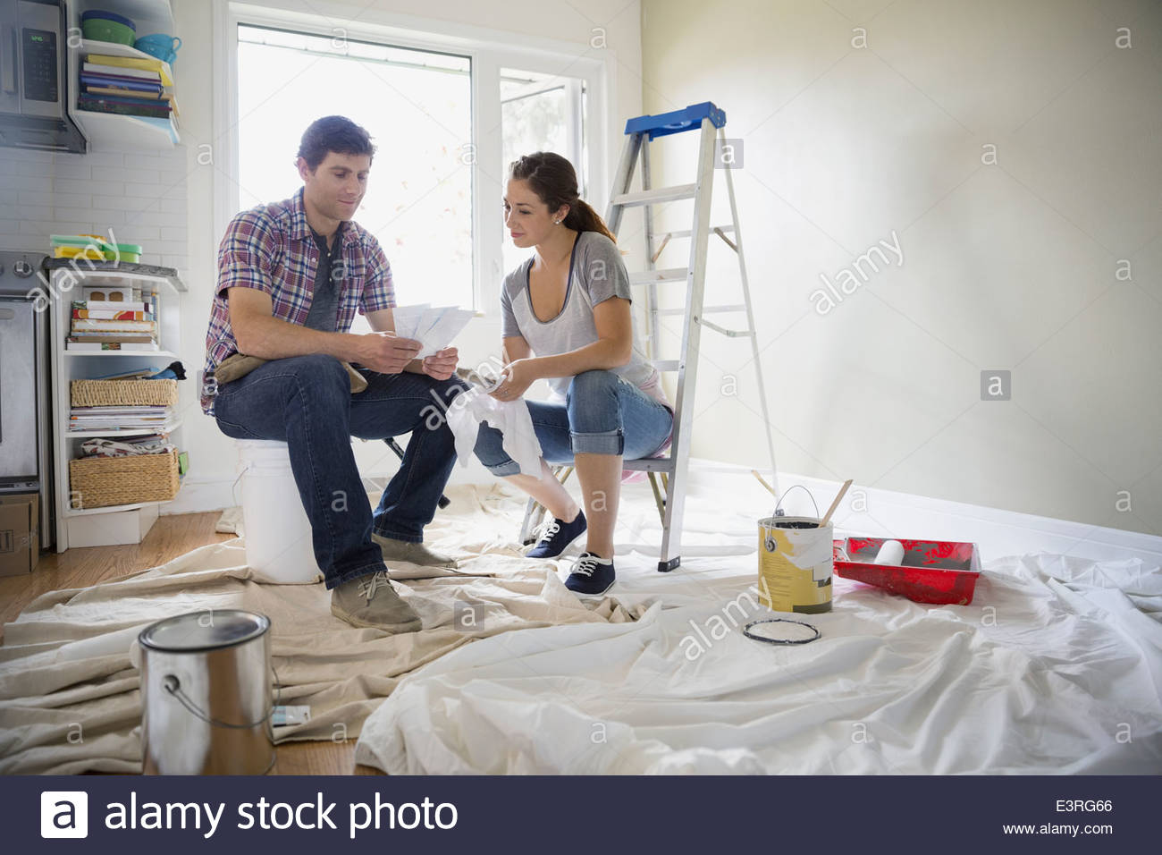 Couple with paint swatches starting painting project - Stock Image