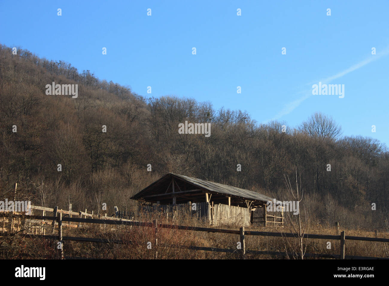 Traditional Romanian sheepfold in green landscape. Stock Photo