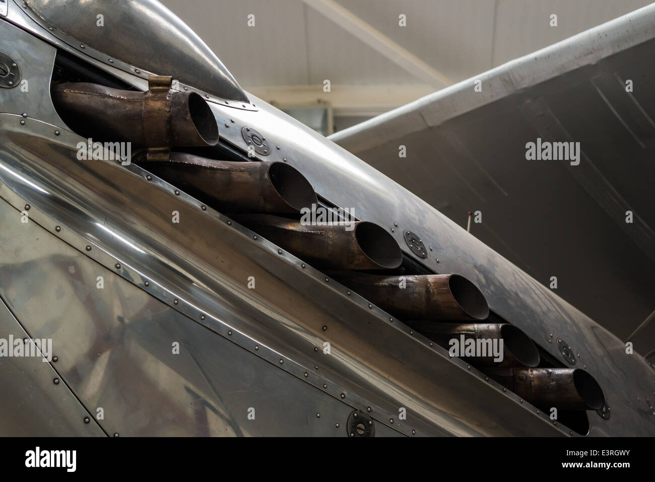 Detail of an exhaust on an aircraft fuselage on display at Shuttleworth Aerodrome, UK - Stock Image