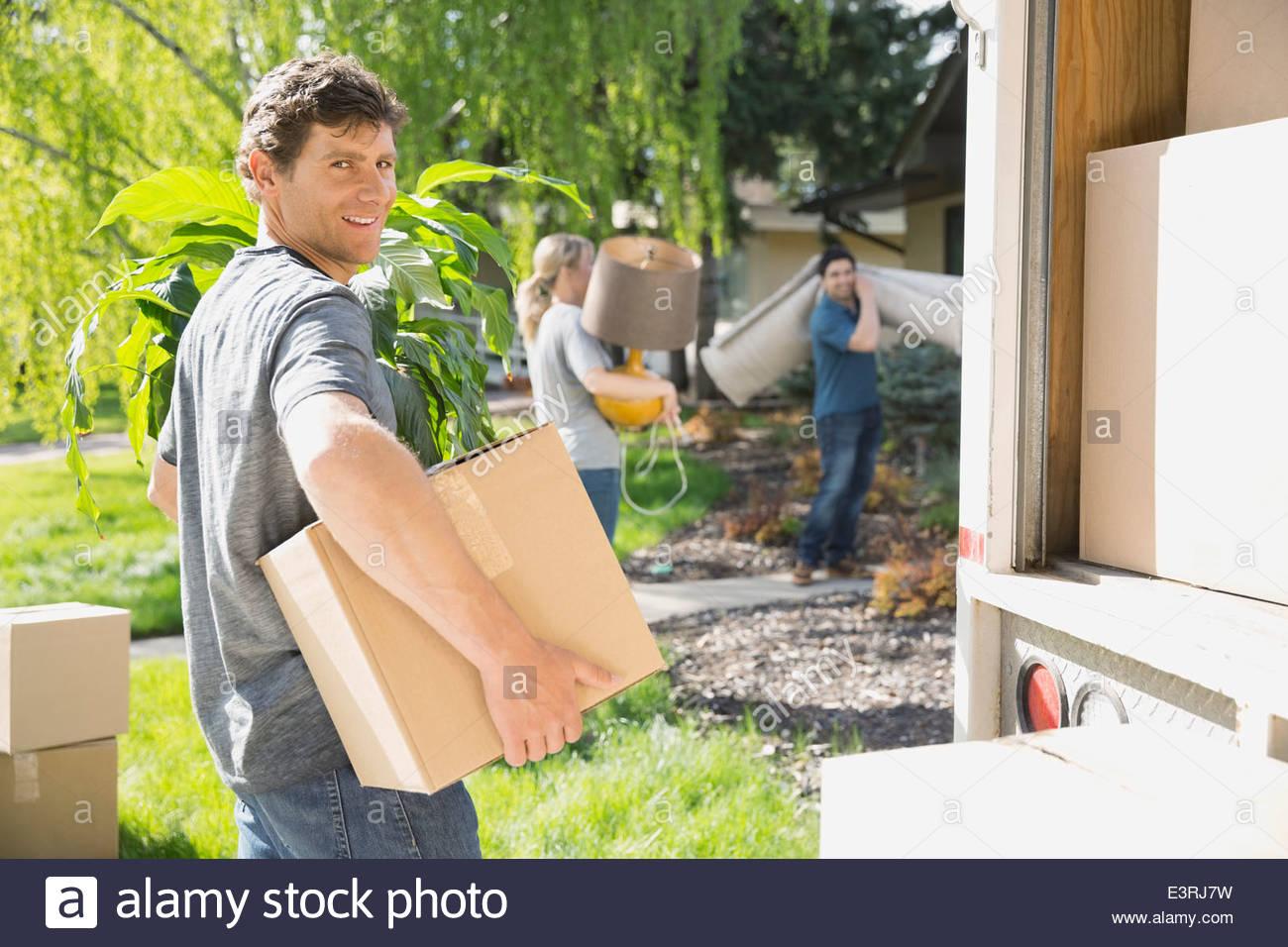 Portrait of man unloading moving van - Stock Image
