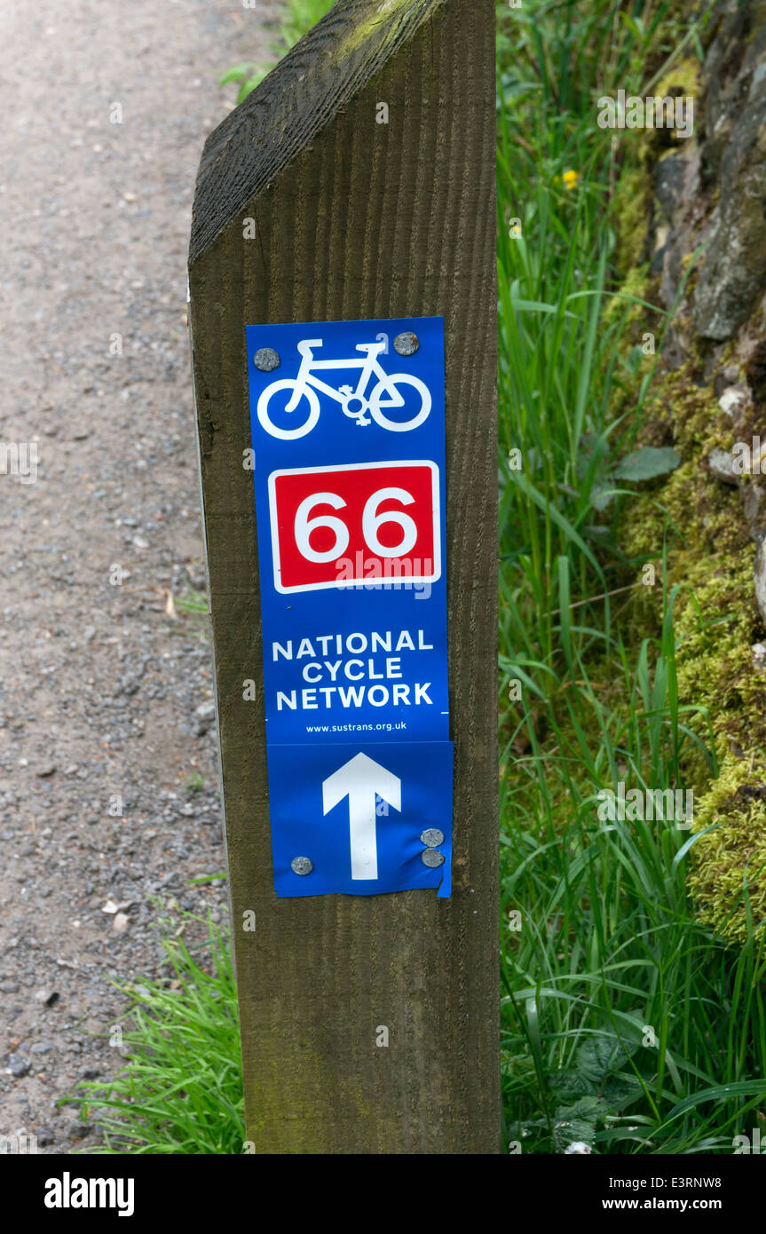 National Cycle Network signpost on the canal towpath near Luddenden Foot, West Yorkshire - Stock Image