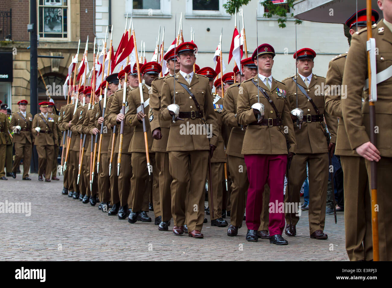 Northampton, UK. 28th June, 2014. The 9th/12th Royal Lancers proudly parade through Northampton town centre as the - Stock Image