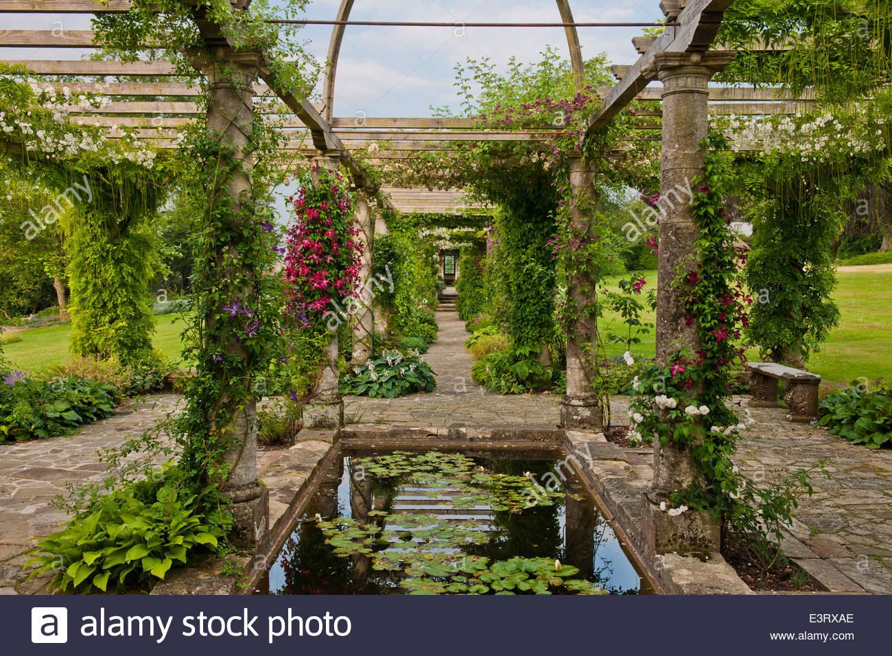 Stone Pergola West Dean Sussex View Summer Climbing Roses Clematis Romantic  Gothic Victorian Garden Feature Sun Sunny Perennial