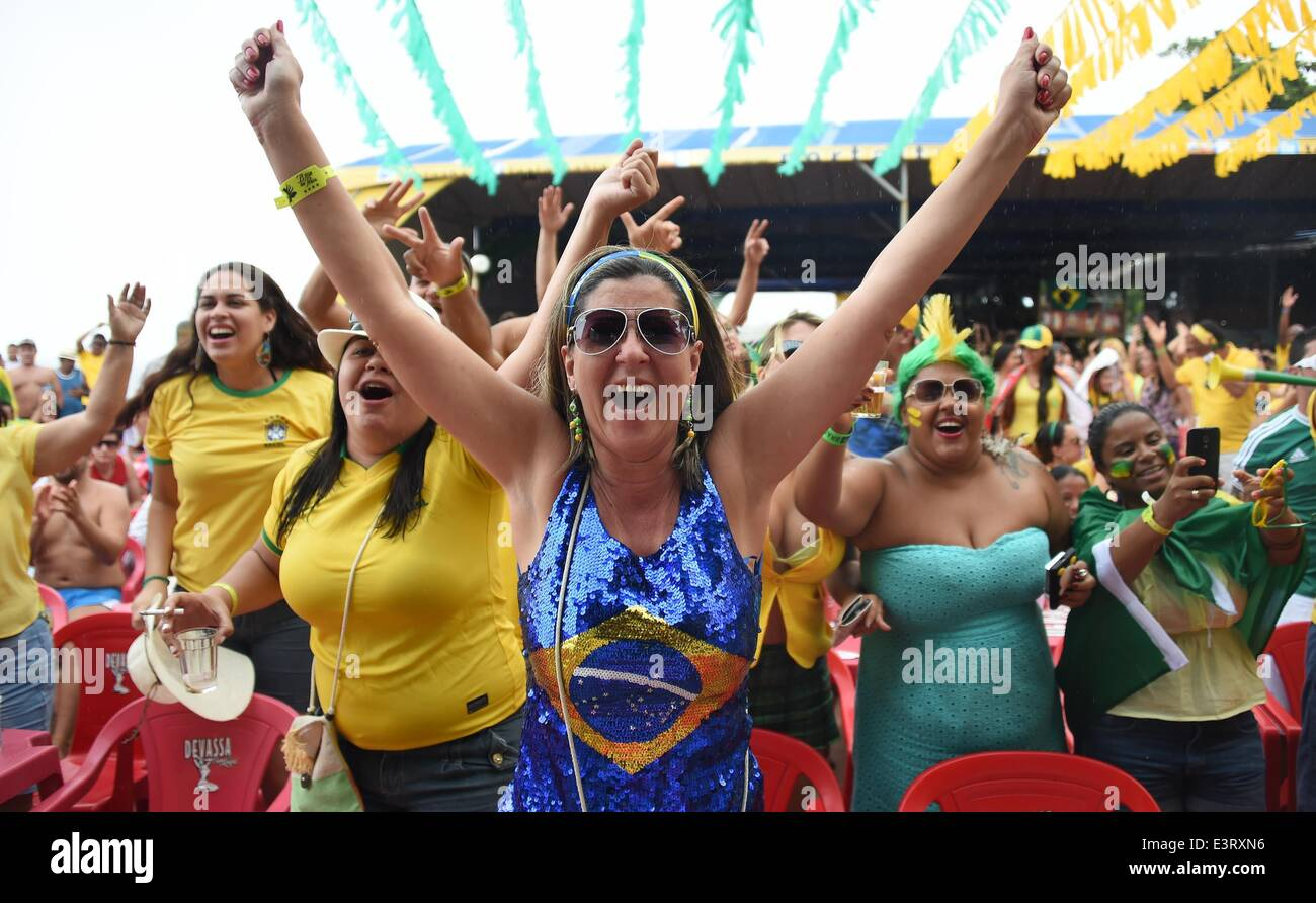 Porto Seguro, Brazil. 28th June, 2014. Brazilians celebrate a goal as they watch the FIFA World Cup round of sixteen - Stock Image