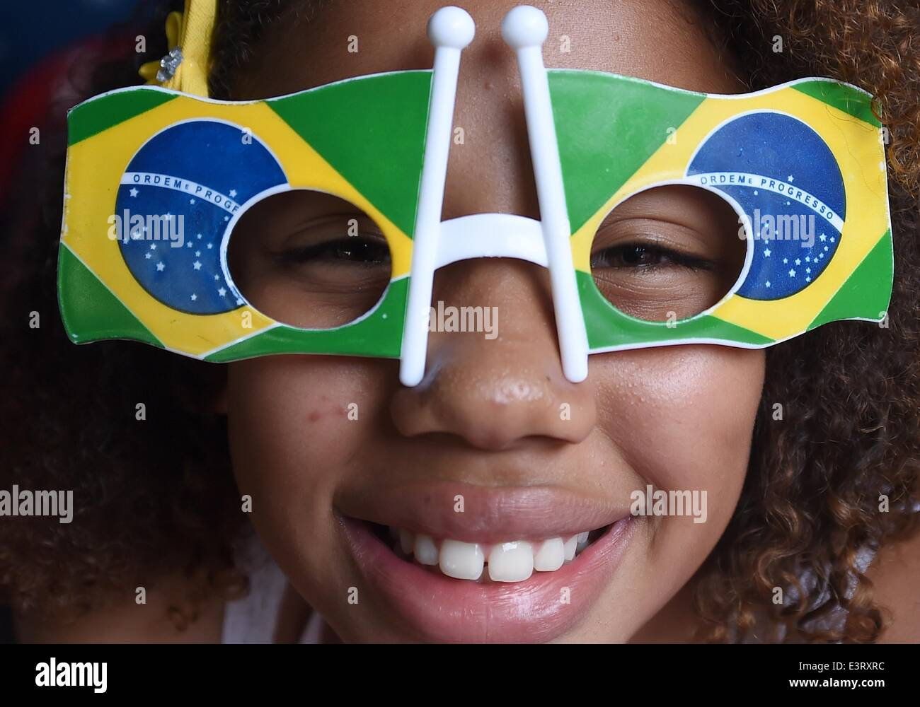 A Brazilian female supporter sports fan items as they watch the FIFAsoccer World Cup round of sixteen match - Stock Image