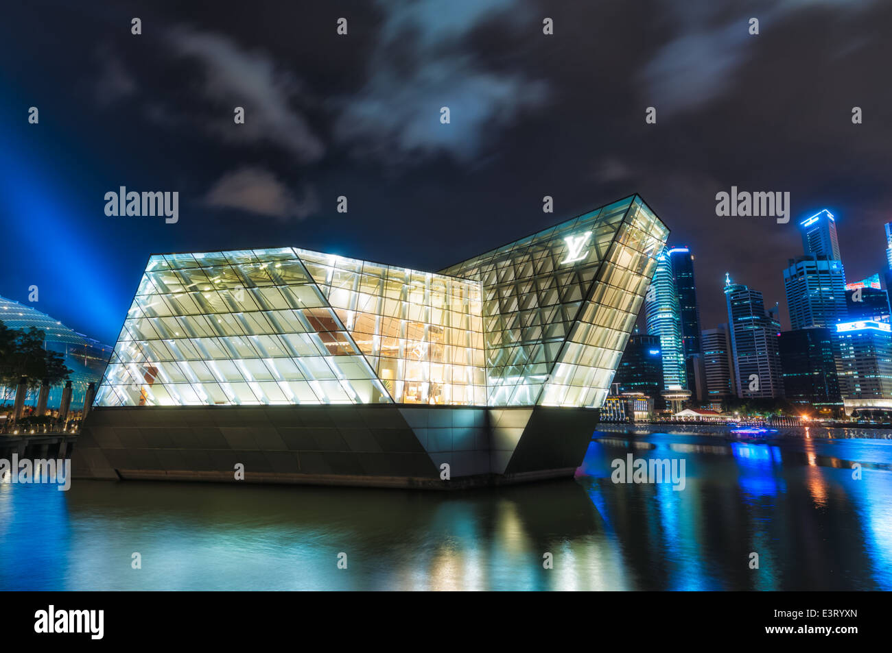 A Louis Vuitton boutique extends out into Marina Bay in Singapore. - Stock Image