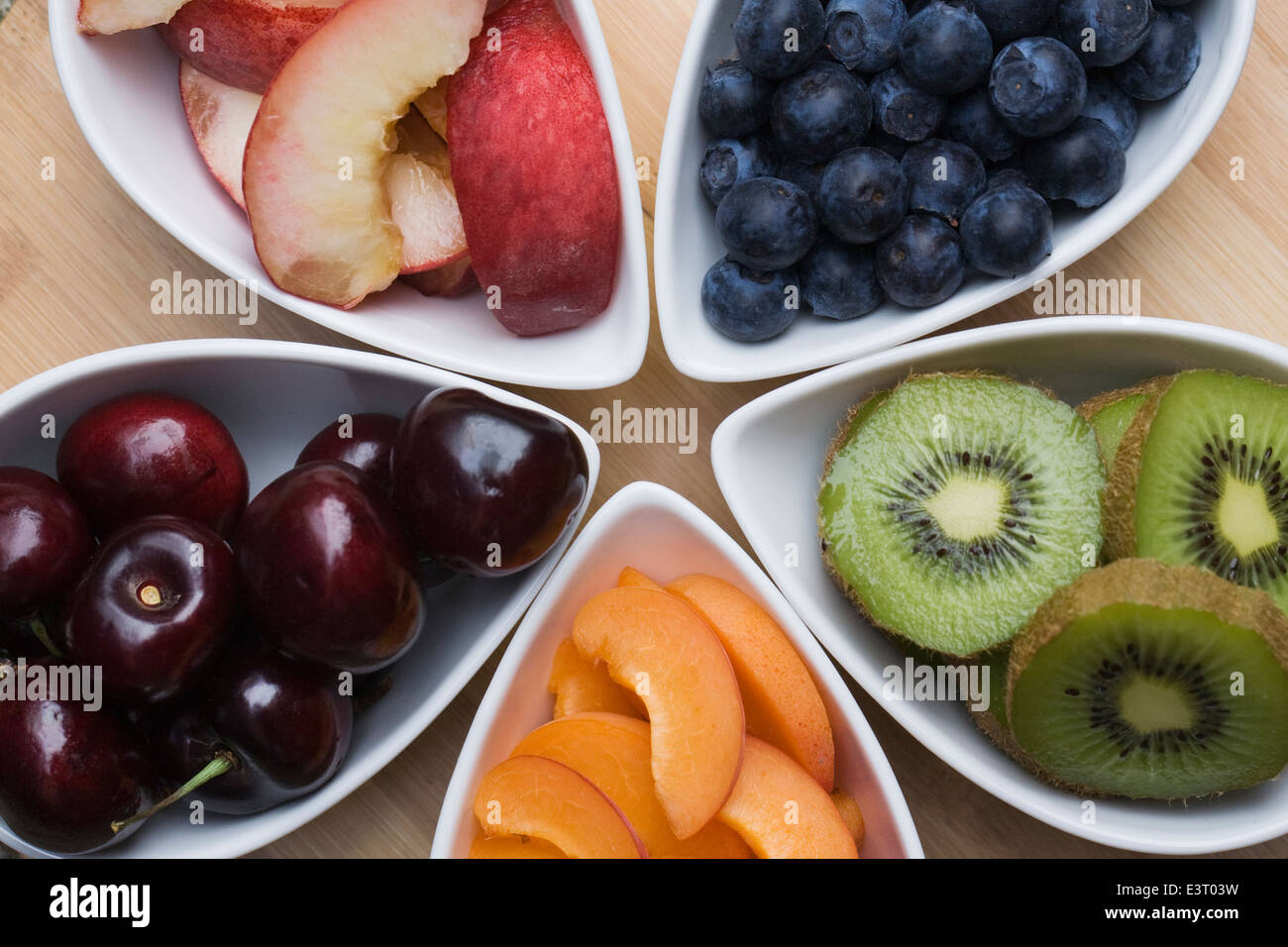 Healthy snacks including apricots, nectarines, cherries, blueberries and kiwi fruit. - Stock Image