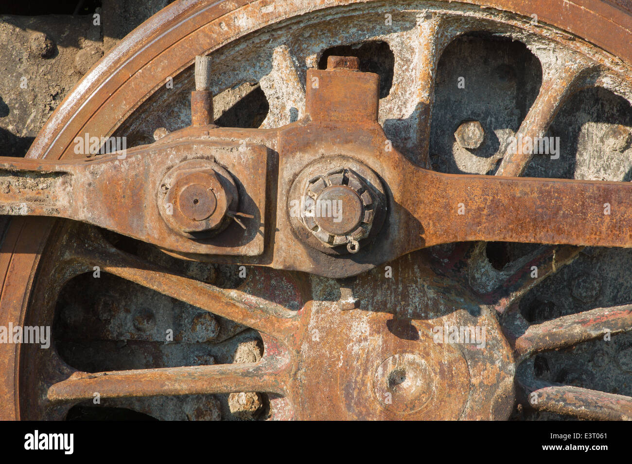 detail of driving rod mechanism on old steam locomotive in rust - Stock Image