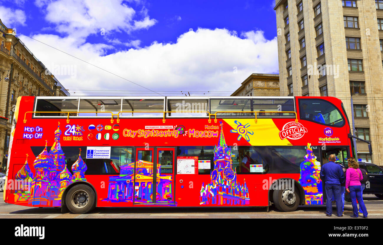 Brightly decorated sightseeing double-decker open top bus in the city centre takes visitors to all the major tourist - Stock Image
