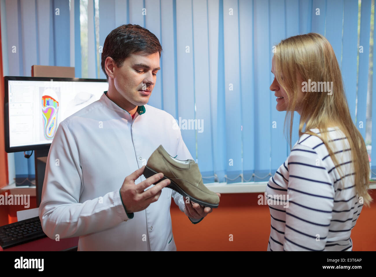 Woman consulting foot doctor - Stock Image