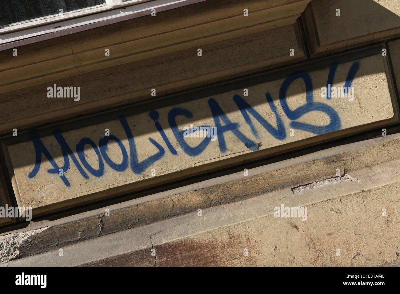 Hooligans. Street graffiti in Olomouc, Czech Republic. - Stock Image