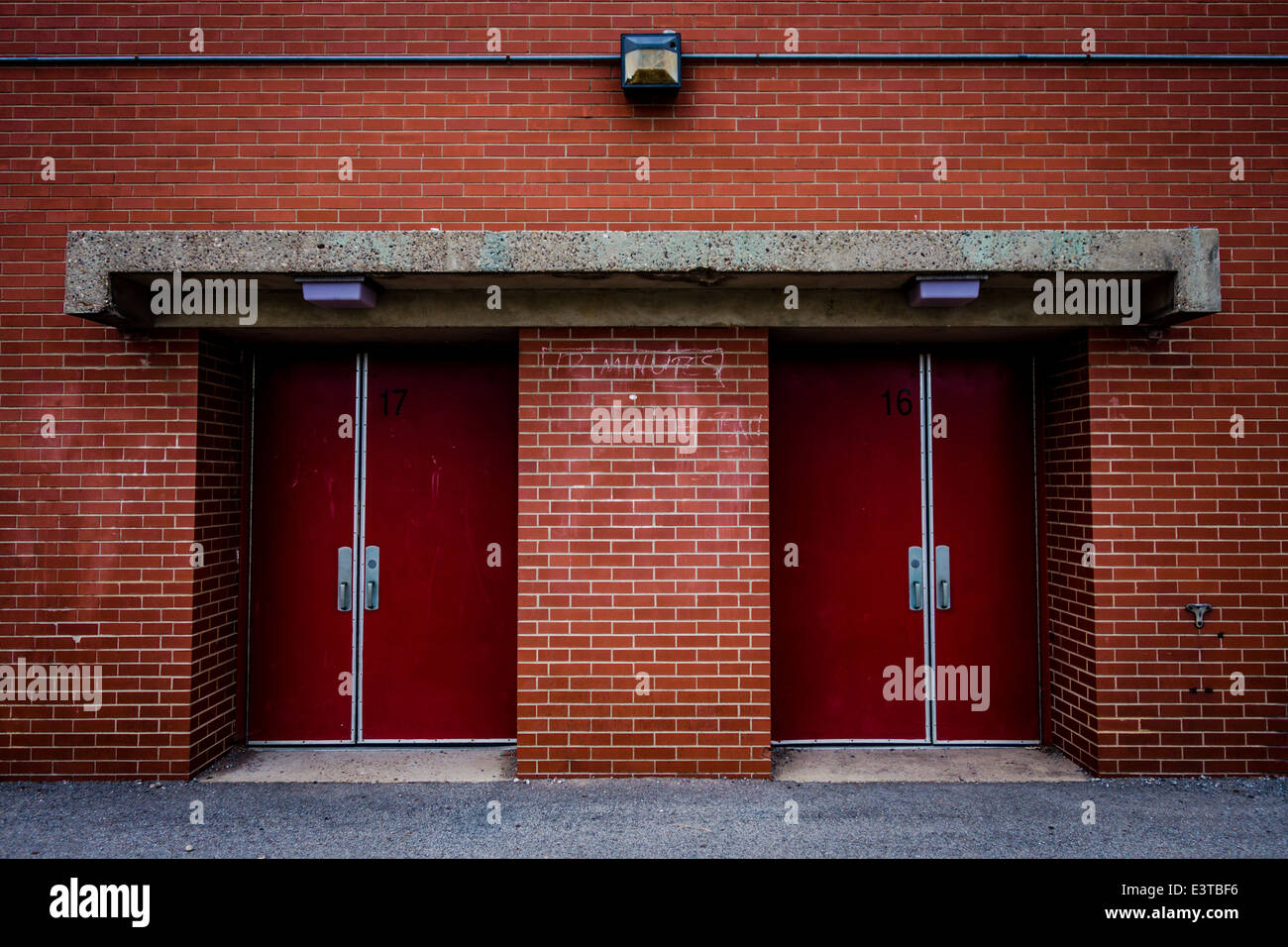 Two closed ed doorways on a red brick building. - Stock Image