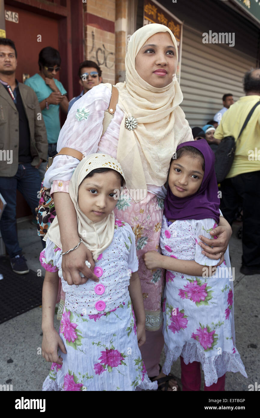 Mother and daughters pose for a photo at street fair in 'Little Bangladesh' in the Kensington section of - Stock Image