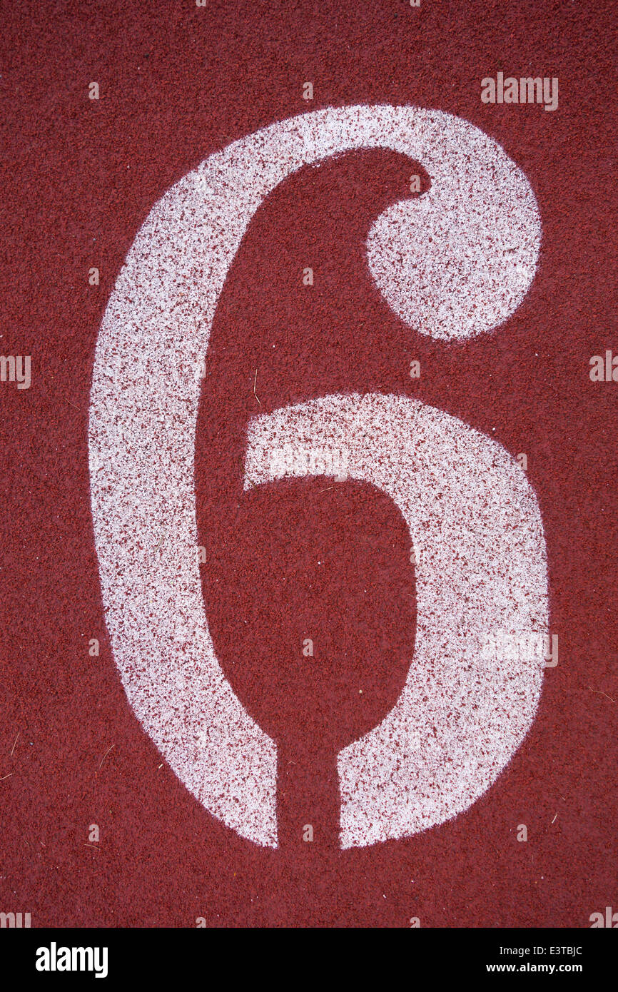 Number six 6, on a running track - Stock Image