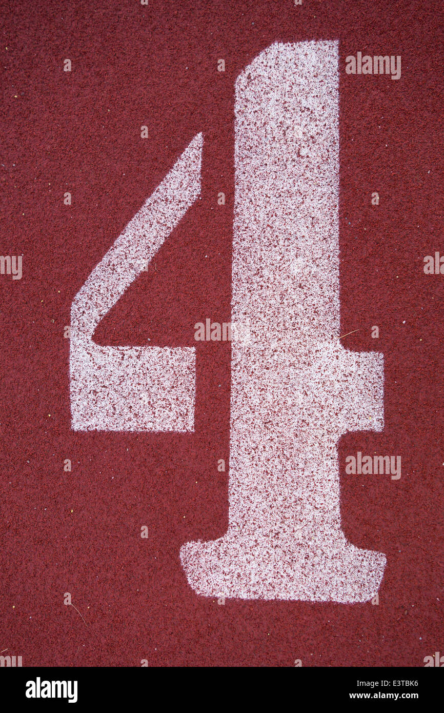Number four (4), on a running track - Stock Image