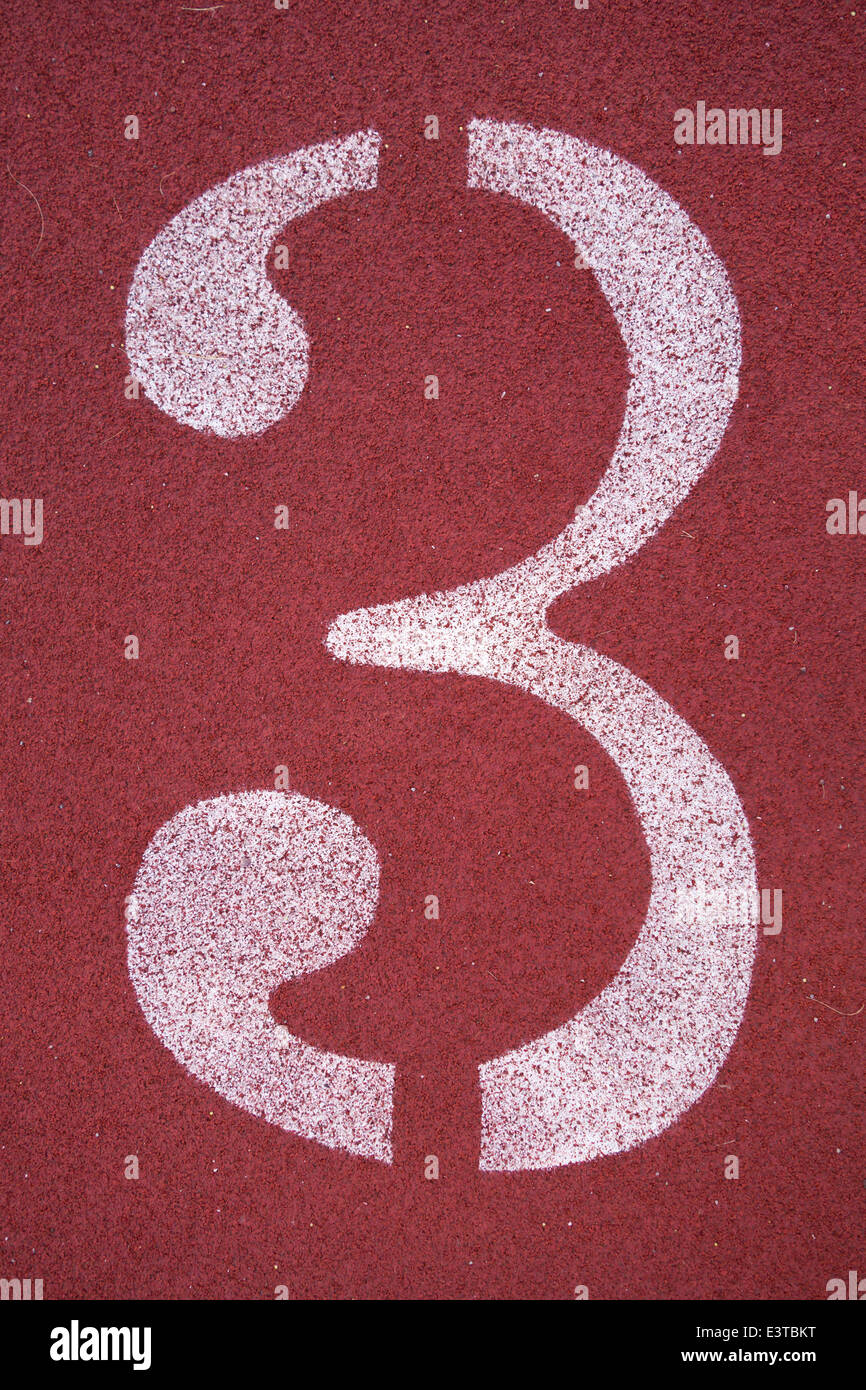 Number three (3), on a running track - Stock Image