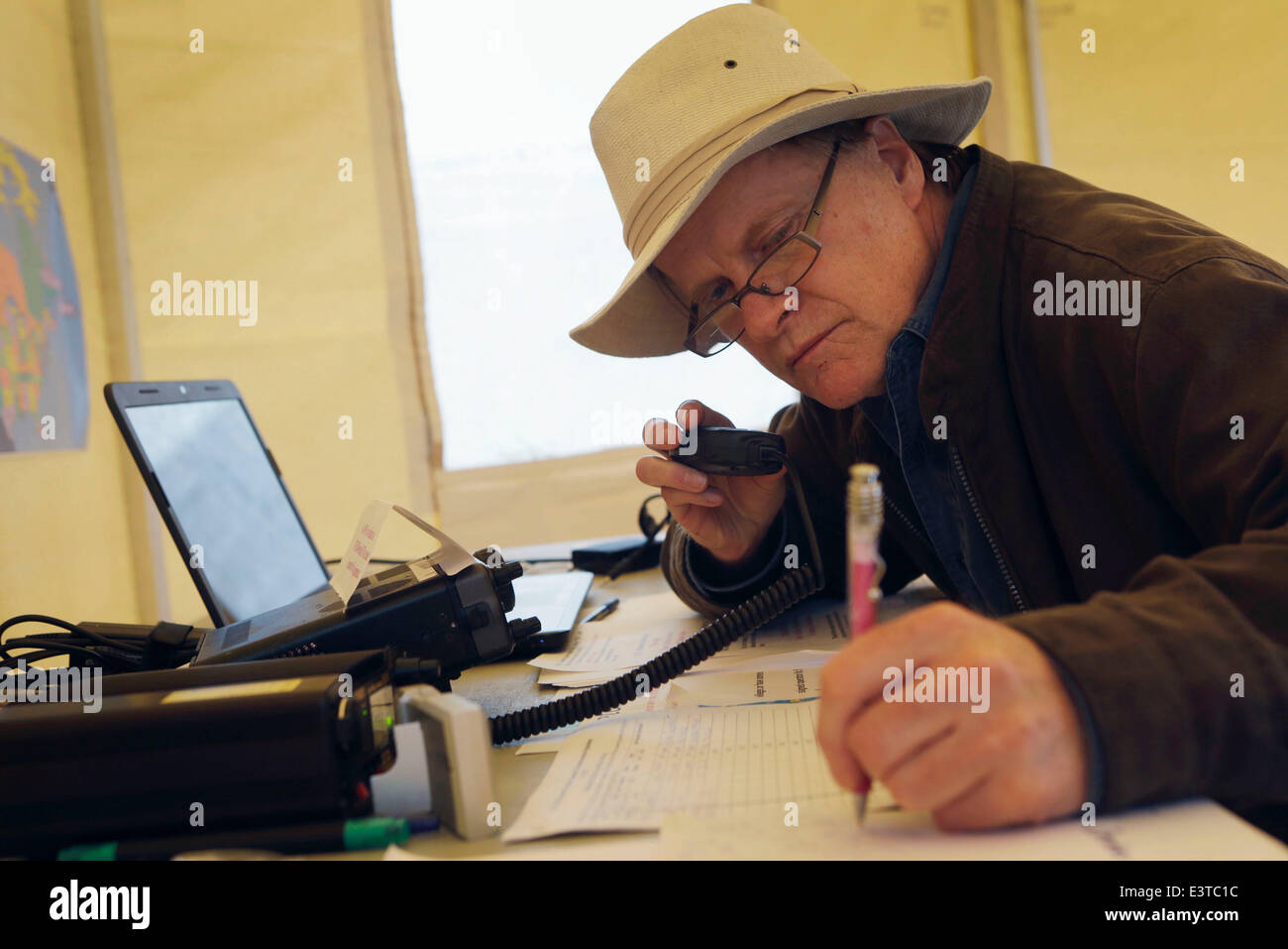 Vancouver, Canada. 28th June, 2014. An amateur radio operator works on the radio equipment during the annual radio Stock Photo